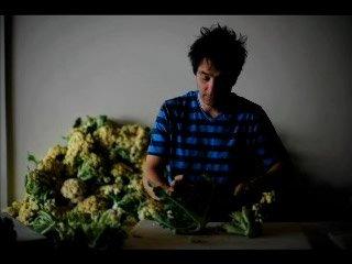 John Taboada checks out cauliflower from 47th Ave Farm